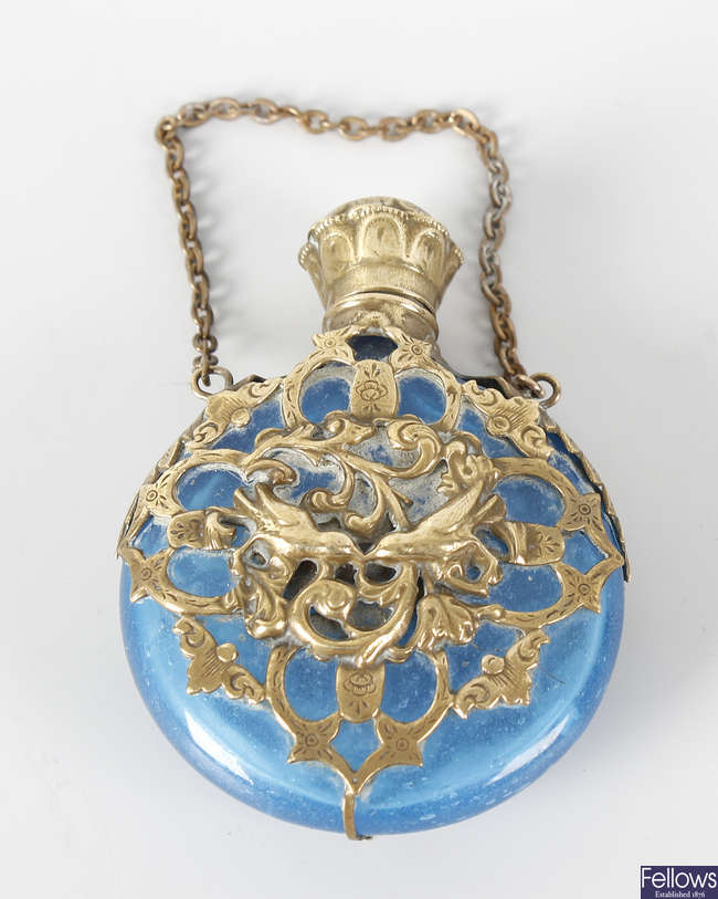 A Victorian circular blue glass bodied scent bottle
