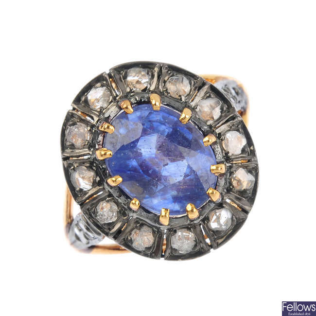 A diamond and glass-filled blue gem cluster ring.