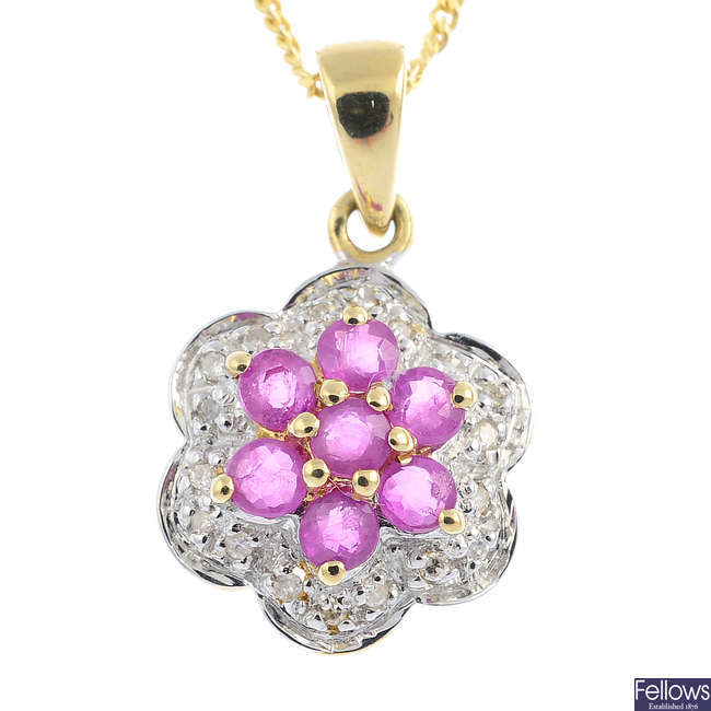 A 9ct gold ruby and diamond pendant, with 9ct gold chain.