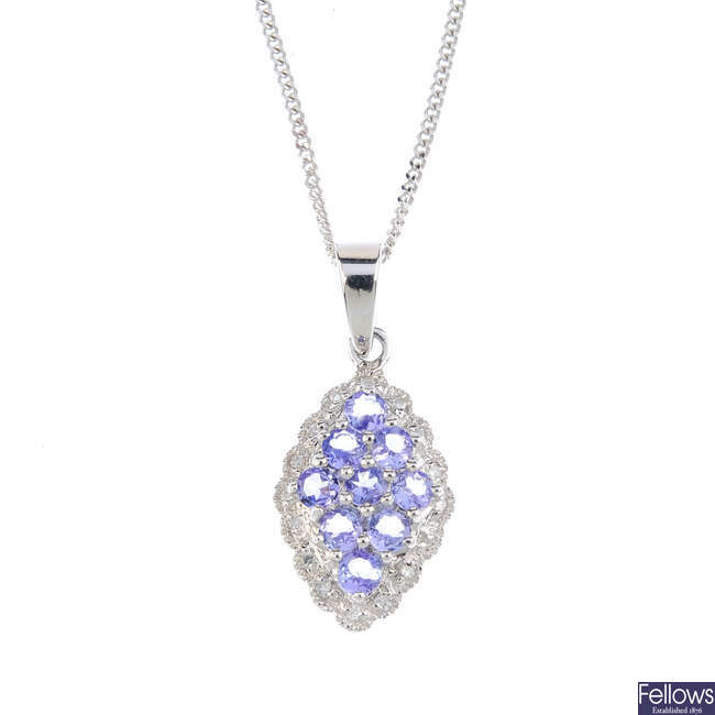 A 9ct gold tanzanite and diamond cluster pendant, with chain.