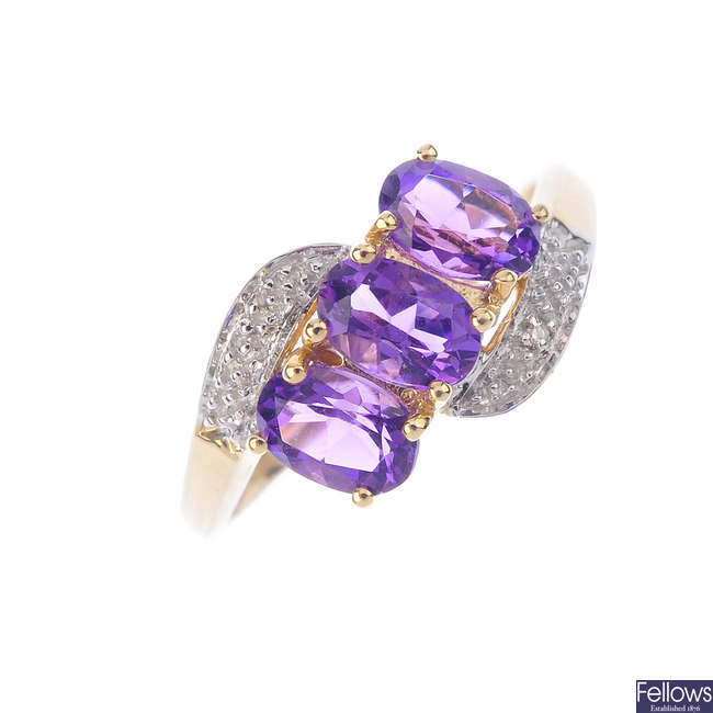 A 9ct gold amethyst and diamond crossover ring.