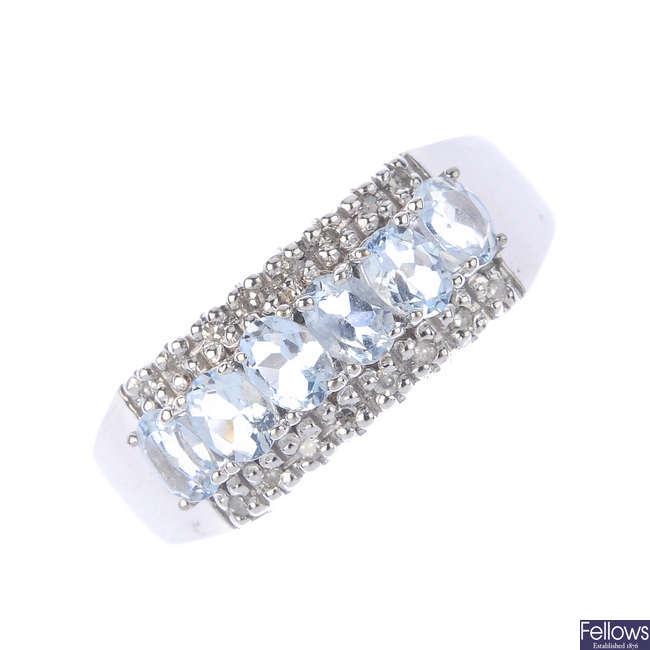 A 9ct gold aquamarine and diamond band ring.