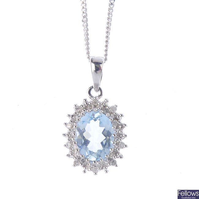An aquamarine and diamond jewellery set.