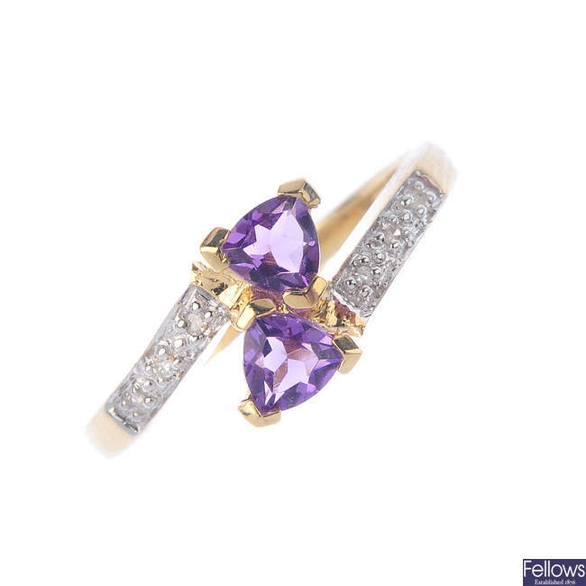 A 9ct gold diamond and amethyst ring.