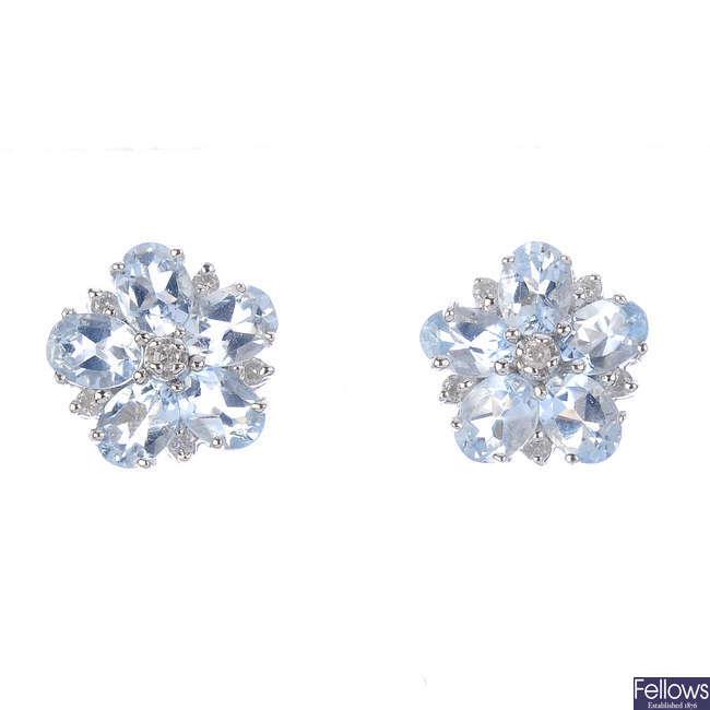 A pair of aquamarine earrings.