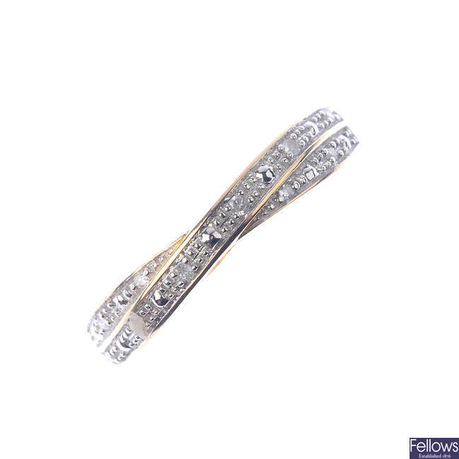 A 9ct gold diamond crossover ring.