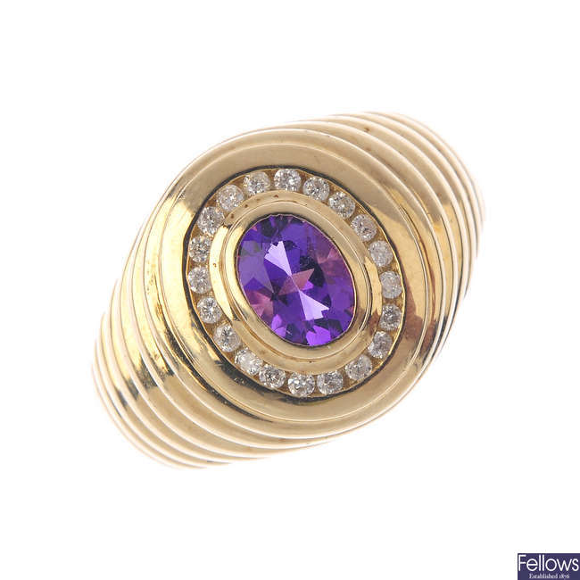 A 9ct gold amethyst and diamond cluster ring.