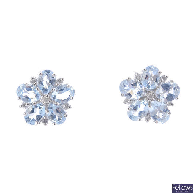 A pair of aquamarine and diamond floral cluster stud earrings.
