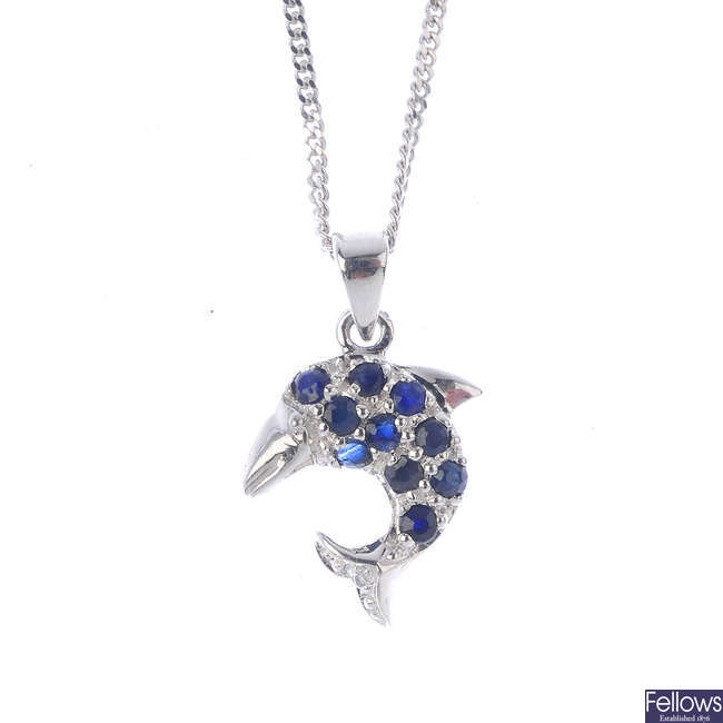 A sapphire and diamond dolphin pendant, with chain.