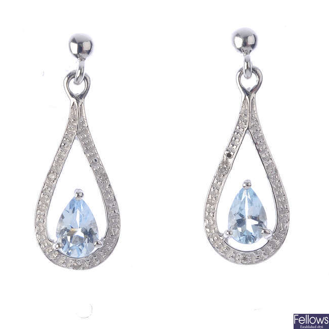 A pair of 9ct gold aquamarine and diamond earrings.