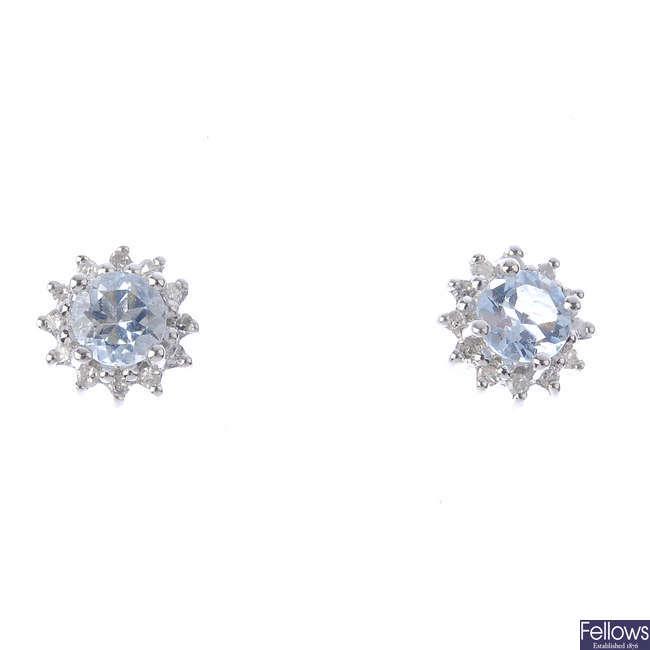 A pair of aquamarine and diamond cluster stud earrings.