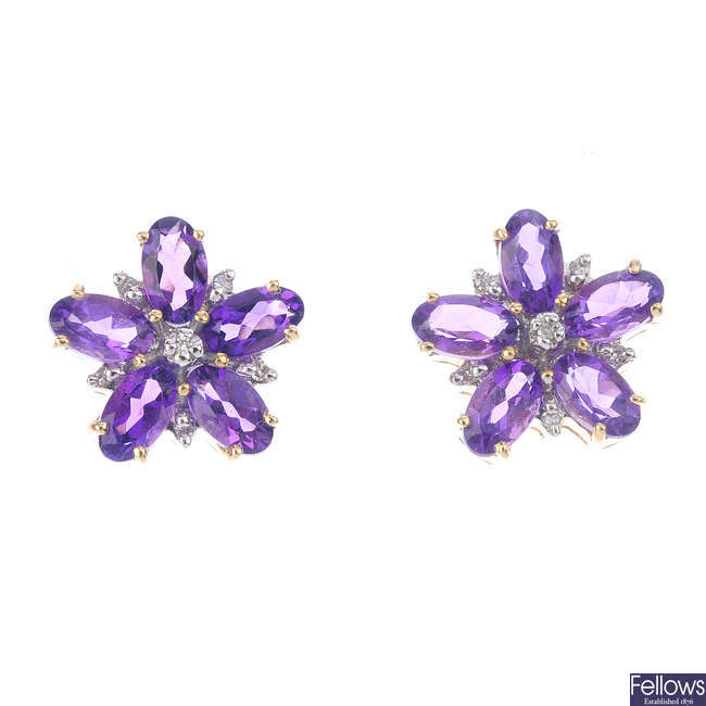 A pair of 9ct gold amethyst and diamond floral stud earrings.