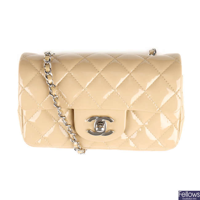 CHANEL - a beige Extra Mini Classic Flap handbag.