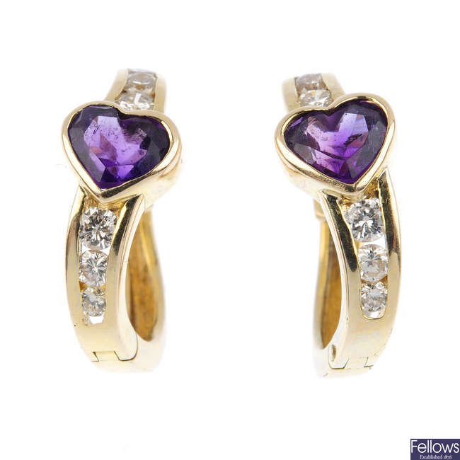 A pair of 14ct gold amethyst and diamond hoop earrings.