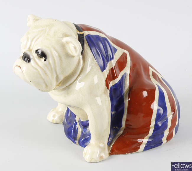 A Royal Doulton study of a bulldog seated and draped in the Union flag.