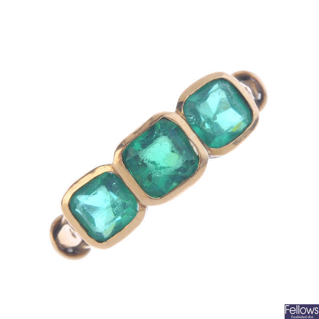 An early 20th century gold gem-set three-stone ring.