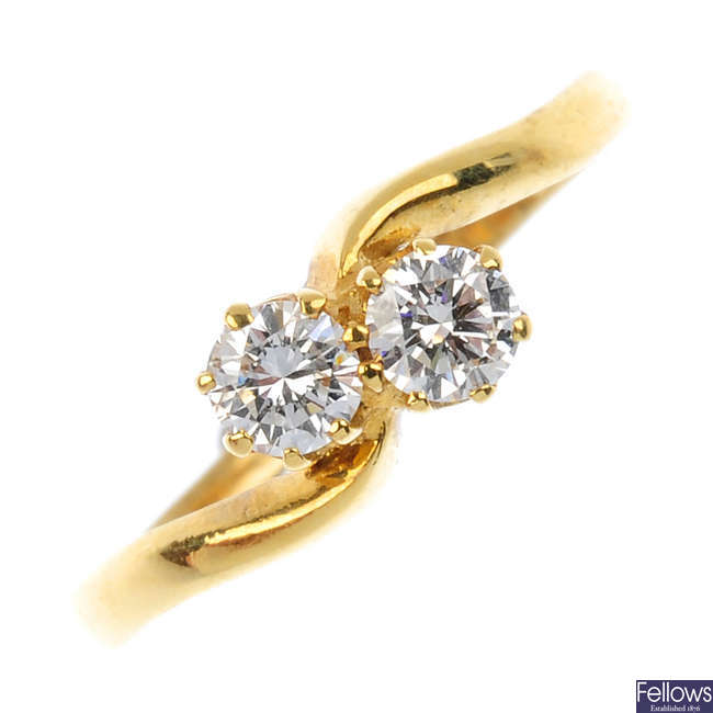 An 18ct gold diamond crossover ring.