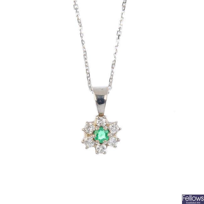 An 18ct gold emerald and diamond pendant.