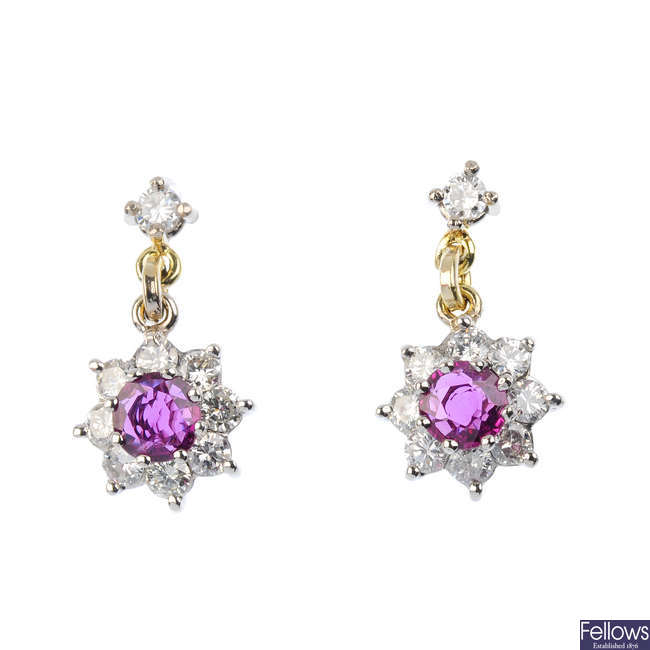 A pair of 9ct gold ruby and diamond cluster earrings.