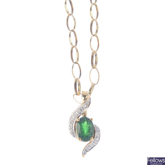 A 9ct gold chrome diopside and diamond pendant, with chain and a pair of earrings.