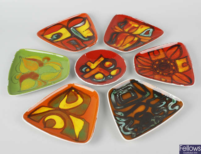 Fourteen various Poole pottery Delphis pattern trinket dishes.