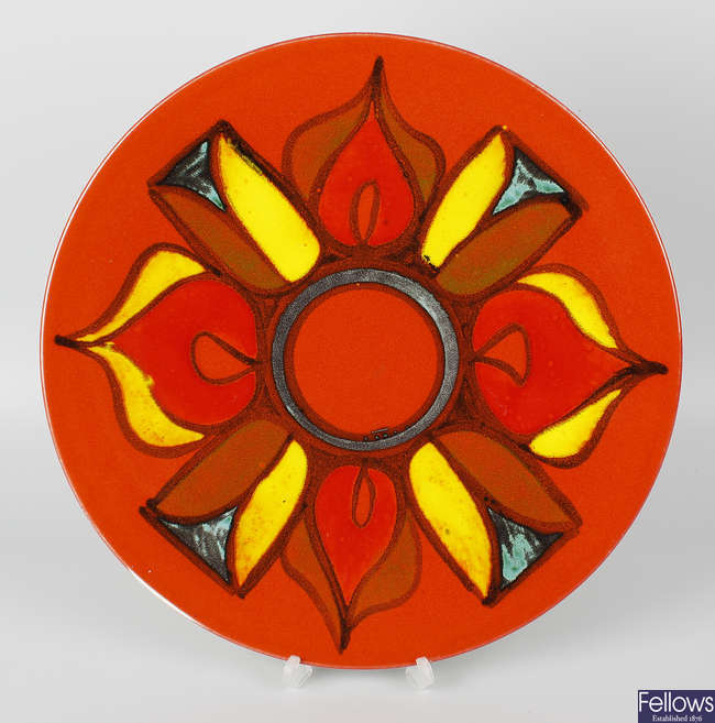 A Poole pottery Delphis pattern circular wall charger.