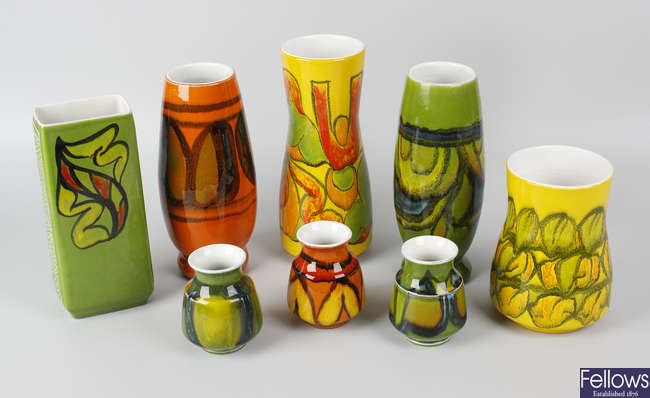 Eight various Poole pottery Delphus pattern vases.