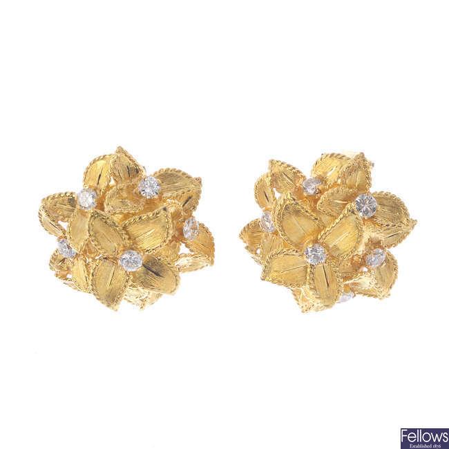 A pair of diamond floral clip earrings.