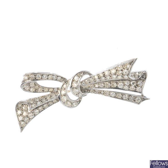 A mid 20th century diamond bow brooch.