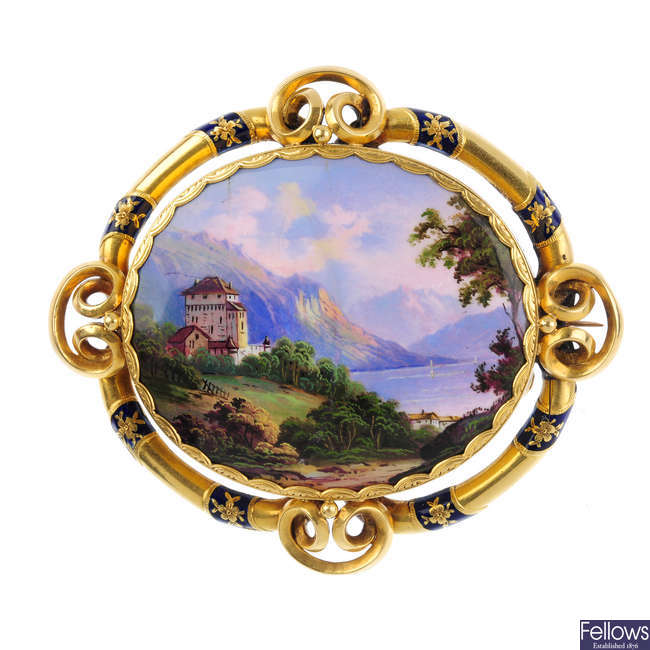 A mid Victorian gold and enamel landscape brooch.