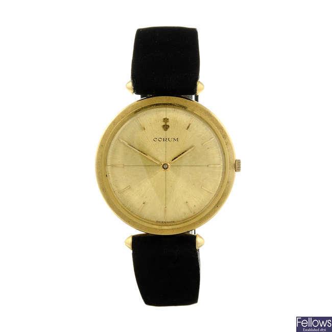 CORUM - a gentleman's yellow metal wrist watch.
