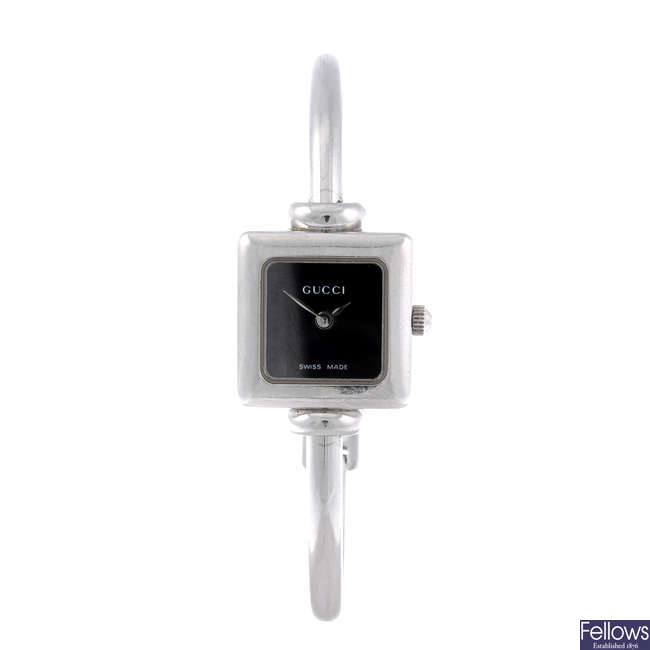 GUCCI - a lady's stainless steel 1900L bangle watch.