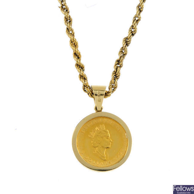 A Canadian coin pendant, with chain.