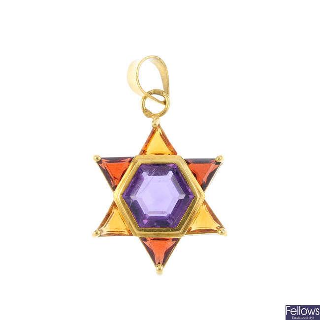 A citrine, garnet and amethyst star pendant.