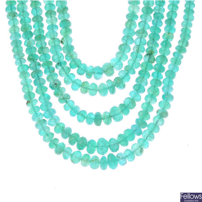 An emerald five-strand necklace.