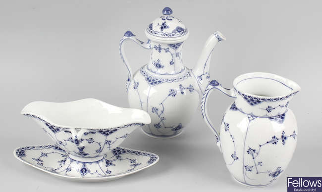 An extensive collection of Royal Copenhagen porcelain half-lace dinner and tea wares
