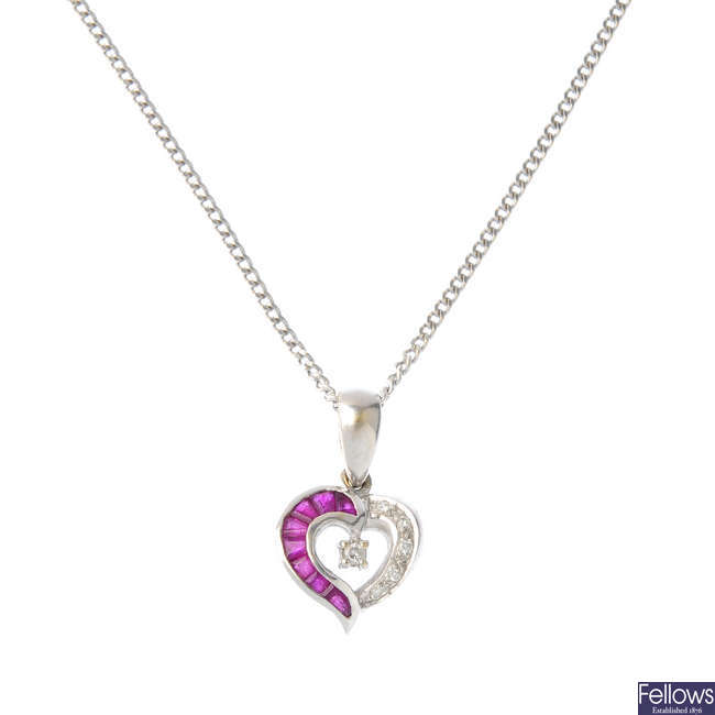 An 18ct diamond and ruby pendant, with chain.