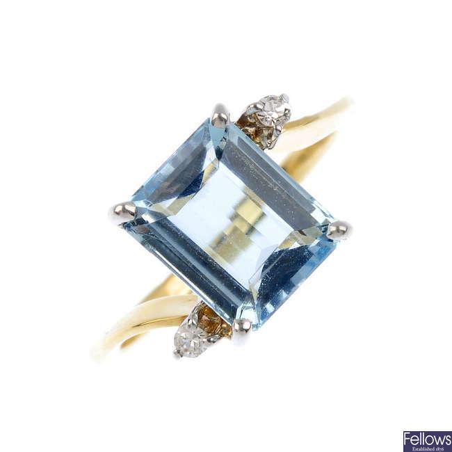 An aquamarine and diamond dress ring.