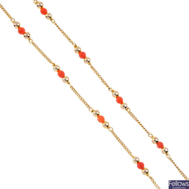 A 9ct gold coral bead necklace.