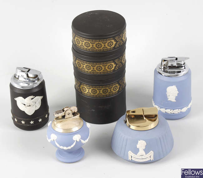 A collection of sixteen Wedgwood jasperware cigarette lighters.