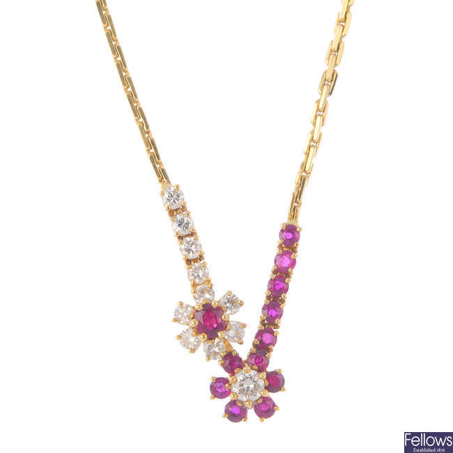 An 18ct gold diamond and ruby necklace.