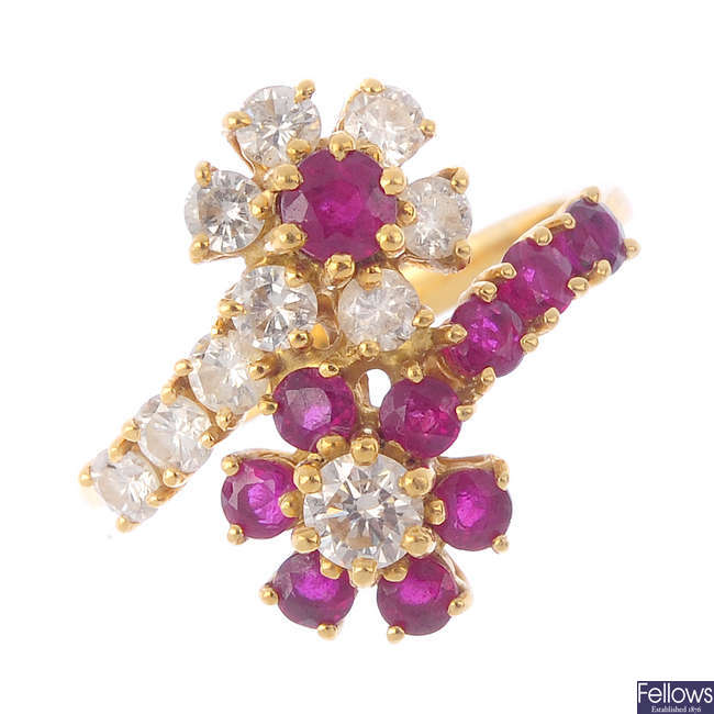 A diamond and ruby cluster ring.