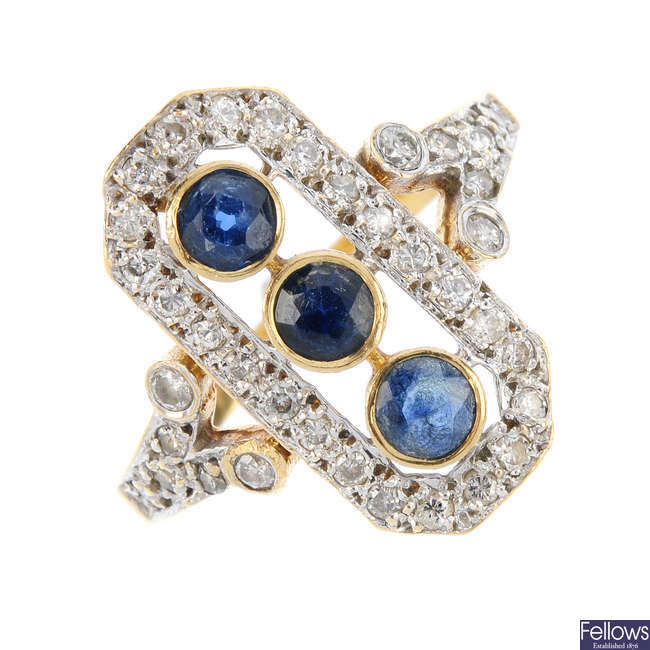 A mid 20th century  gold sapphire and diamond dress ring.