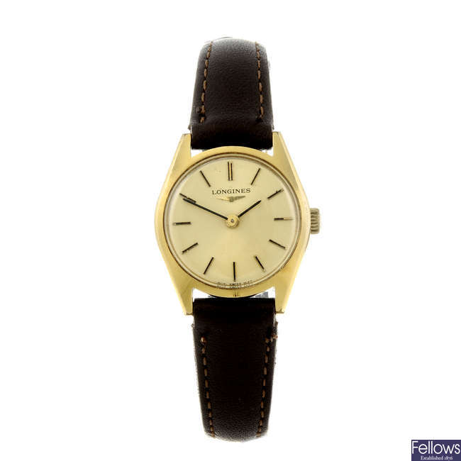 LONGINES - a lady's gold plated wrist watch.