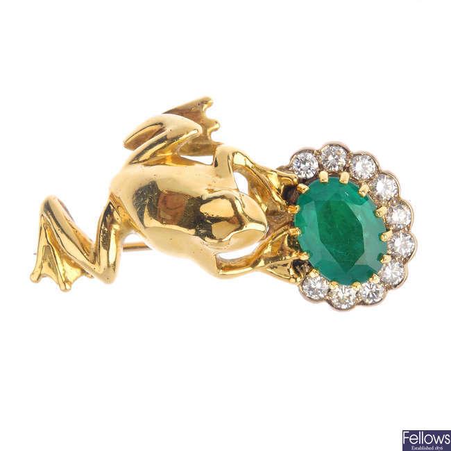 An emerald and diamond frog brooch.