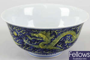 A good Chinese blue and yellow enamelled dragon porcelain bowl