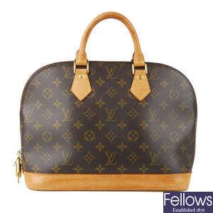 3a8d88a4b6 LOT:267 | LOUIS VUITTON - a Monogram Saumur 43 handbag.