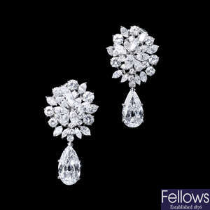 A pair of diamond earrings, with pear-shape diamond drops of 3.98 and 3.15cts respectively.