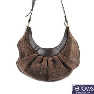 38635f69c57 GUCCI - a GG canvas Buckle Tote handbag. Lot 364